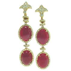 This is an elegant pair of oxblood red coral dangle earrings by LAURA MUNDER, with 2.22cts of fine diamonds.
