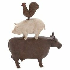 """Showcasing a whimsical design of stacked farm animals, this charming decor adds a cheerful touch to your credenza or mantel.   Product: DecorConstruction Material: AluminumColor: MultiFeatures: Stacked farm animal motifDimensions: 15.5"""" H x 13"""" W x 4"""" D"""