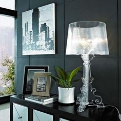 Give the illusion of a floating light and make your space feel larger with an acrylic lamp.
