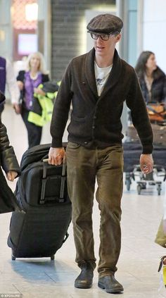 Hats off to him: Benedict looked every inch the English gent when he arrived in London