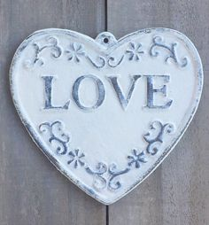 """Heart shaped """"Love"""" plaque cast iron distressed in cream color by TrueNorthHome on Etsy https://www.etsy.com/listing/487664707/heart-shaped-love-plaque-cast-iron"""