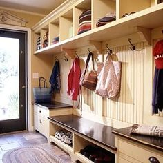 Mudroom storage to die for - this is gorgeous! I need a real builder in this house...