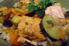 Instead of lamb or chicken that requires hours of marinating and stewing, this salmon tagine is as quick and light as the cous cous it sits upon. Made with olives, oranges, eggplant, zucchini, and apricots, this dish is easy, healthy, and fragrantly spiced.