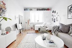 Light & feminine studio apartment. Are you looking for unique and beautiful art photos or poster prints (not the ones featured in this pin) to create your gallery walls? Visit bx3foto.etsy.com and follow us on IG @bx3foto #gallerywall #artwall #photoprints #artphotos #finephotography #posters #bx3foto