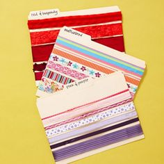 Wrap ribbons by colour groups on as many index cards as required and then make a box that's big enough to store them