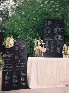 chalkboards all lined up with names + florals