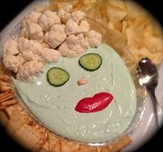 Spa lady, adapted idea from Pinterest. French onion dip with green food coloring, cucumber eyes, mushroom nose,red pepper lips and cauliflower hair on an oval dollar store plate.