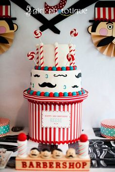 Mustache cake. I like the colors. Red, aqua blue along with the white and black.