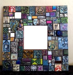 The happiest of artists made this mixed media, collage mirror. Featuring one-of-a-kind, hand crafted polymer clay tiles, its certain to make a