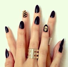 acrylic nail designs gold skull and spikes