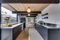 Thisdouble gable Rummer in Beaverton Oregon has gone through a nicely done renovation. Portland has a long history of Rummer homes, like Eichler houses