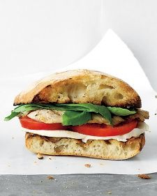 Turkey Caprese Sandwich  INGREDIENTS  Ciabatta roll, split Olive oil 1 thin turkey cutlet Coarse salt and ground pepper Mozzarella, thickly sliced Tomato, sliced Fre...
