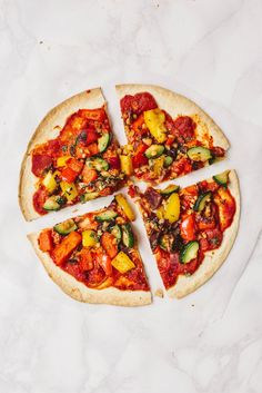 Vegan Tortilla Pizza with spicy arrabiata sauce and Mediterranean vegetables - only 180 kcal per pizza! Gluten-free option.