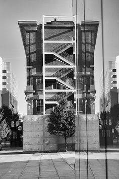 Mirrored Temple - Temple for the Performing Arts reflected in the Downtown Library, Des Moines, Iowa | © 2013 Michael F. Hiatt