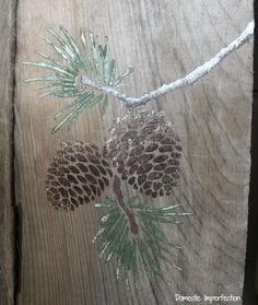 DIY Stenciled pallet art with the Pine Cone Stencil and acrylic craft paint.. http://www.cuttingedgestencils.com/pine-cones-stencil.html