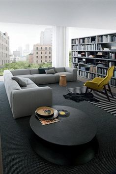 POLIFORM: Ventura Lounge armchair, Soori table, Dama coffee table, Bolton sofa and Wall System bookcase