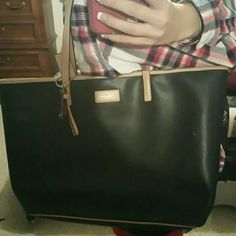 Coach Purse A black leather coach bag with tan trim. The bag can be used as a purse or as a work bag because it has a lot of space inside. In good condition with a few white marks on the front from use! Coach Bags Totes
