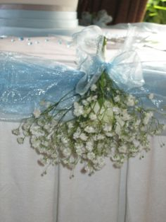 Table swagging corsage of gypsophila with white spray rose