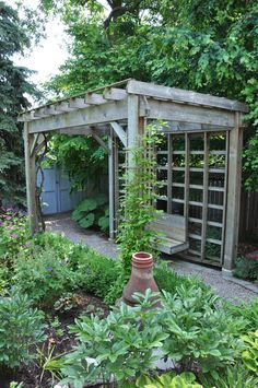 A standout feature of the back garden is this bench and pergola.