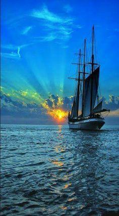 A ship sailing into the sunrise