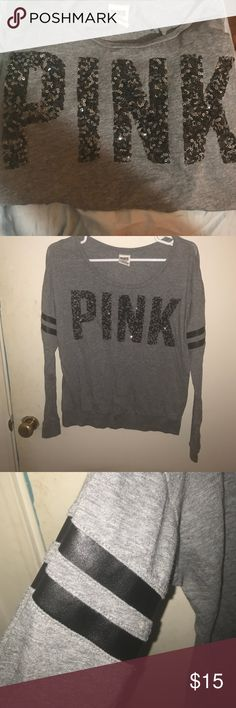 Victoria's Secret Pink long sleeve gray tee Sparkly sequined PINK across chest. Leather look stripes on each arm. Long sleeve. Gray. Gently worn. Size medium. PINK Victoria's Secret Tops Tees - Long Sleeve