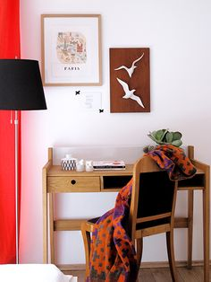 Beautiful working space in shades of red. The simple and beautiful wooden bureau is a great furniture for every home office.
