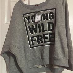 Rue 21 YOUNG,WILD,FREE. sweater Brand new sweater from rue 21 fits more like a Large Rue 21 Sweaters Crew & Scoop Necks