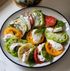 Caprese Salad with Burrata, Heirloom Tomatoes and Basil/Cilantro Pesto