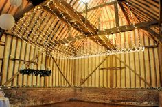 Fairy light canopy over the dancefloor end of the barn at Lillibrooke