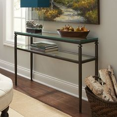 Short on room but long on style? Lincoln savors space as much as you do. This compact console table fits easily into small entryways or behind loveseats. A slender bronze-colored frame and clear, tempered glass top and shelf add even more visual space. Small console, big consolation. Works for us.