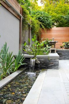 a garden waterfall can be spruced up with pebbles to look more Asian like