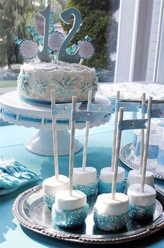 Frozen Birthday Party cake and marshmallow pops!  See more party ideas at CatchMyParty.com!