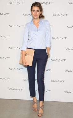 Crisp & Cool from Louise Roe's Best Looks From New York Fashion Week Spring 2016 For this look, Louise pairs a sky blue blouse with a tailored pair of navy trousers.