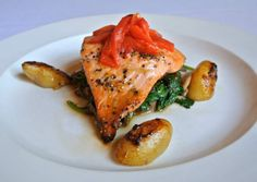 Menu Item: Grilled Alaskan Salmon with Honey Dijon Glaze over oyster mushrooms & sautéed spinach served with fingerling potatoes.