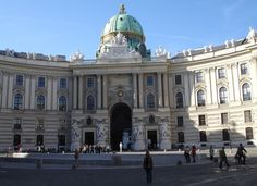 This photo shows the entrance of the Hofburg Palace. it houses all the gold belonging to the Habsburg Dynasty .