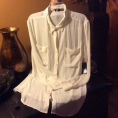ANA button down xl shirt ANA button down shirt never worn with tags. This shirt is extra long so it would be great with some cute leggings. ANA Tops Button Down Shirts