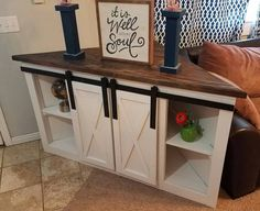 Corner TV console with sliding barn doors all ready for delivery.  #yonderwaywoodshop modified from plan http://www.ana-white.com/2015/08/free_plans/grandy-sliding-door-console