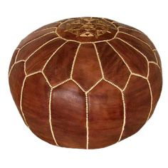 Handmade in Morocco - Brown Leather Pouf.  This would be amazing in the right place and the right decor.