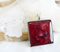 Orgone Positive Life Force Energy Orgonite Pendant - Silver Square Red With Garnet. $30.00, via Etsy.