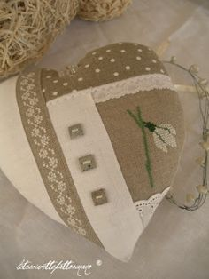 A cute idea for a beige linen heart pincushion