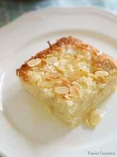 This Coconut Almond Ricotta cake has a crunchy coconut and almond top and sweet coconut milk glaze.