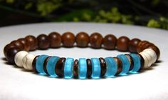 This wood beaded bracelet for men is made with 8mm Creamy Howlite and Robles wood with Coco Wood and Blue Sea Glass beads. Howlite Properties: This calming stone is said to teach patience and to help