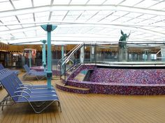 The ship's enclosed pool area is perfect for cruising to Alaska or on rainy days at sea