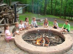 Awesome fire pit - LOVE the wide border to help kids hold marshmallow sticks in one place over the coals