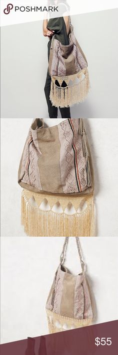 FP light my fire tote❣️❣️ Used maybe 1x! Absolutely stunning! I just have too many purses 🤷🏻♀️😭🙈 the fringe is amazing!! Perfect purse for fall ❤️😍 Free People Bags