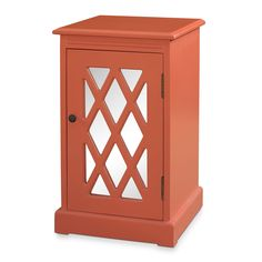 Mini Design Classic. The Story side table in coral is an attractive means of supplying extra storage. Diagonal wood strips in a lattice shape represent a classic Chippendale-inspired design over a mirrored door. Two interior shelf spaces bring extra function. The coral finish is a bright, bold accent color for your living room or bedroom.   A web-exclusive product. Item is not displayed in store, but may be ordered there.