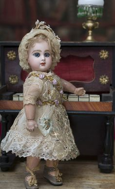 """9 1/2"""" (24 cm.) Antique French Bisque Bebe Jumeau, closed mouth, Size 1 Antique dolls at Respectfulbear.com"""
