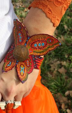 Hand painted leather Junk Gypsy cuff http://www.horsesandheels.com/2012/01/bold-bright/