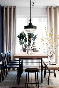 decordemon: Apartment in Sweden in dark green and blue tones.