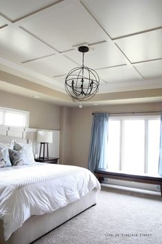 Master Bedroom with Board and Batten Ceiling and Orb Chandelier